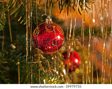 Christmas decoration beautiful red golden balls on a festive tree