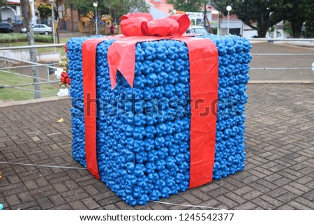 Christmas decoration: big gift boxes made of colorful recycled plastic bottles