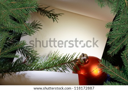 Christmas decoration. Blank scroll for text between fir twigs on dark background