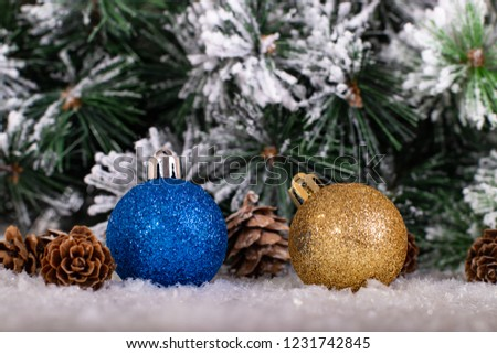 Christmas decoration blue and gold balls with tree in snow