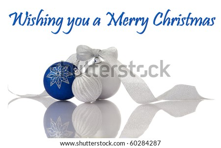 Christmas decoration blue and silver balls with ribbon on white with reflection