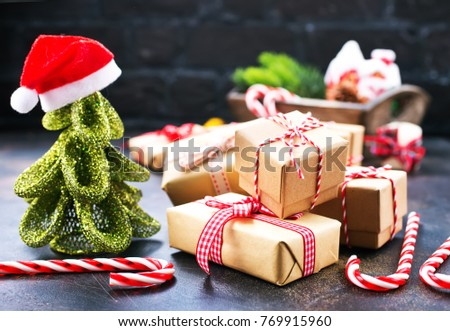 christmas decoration, box for present on a table #769915960