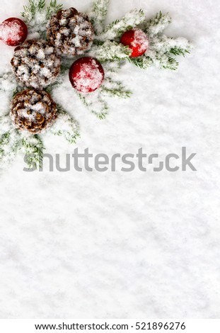 Christmas decoration. Branch christmas tree, christmas balls and cones pine on snow. Top view, flat lay