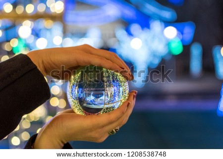 Christmas decoration caught through a glass sphere. #1208538748