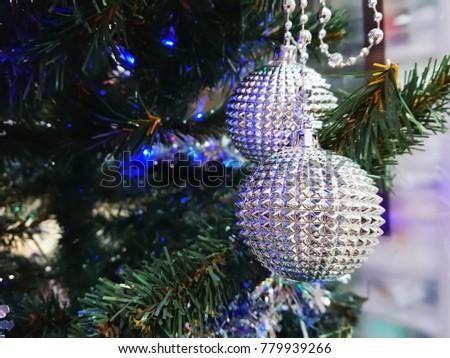 Christmas decoration. Christmas decoration background; Christmas tree and holidays ornament. #779939266
