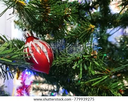 Christmas decoration. Christmas decoration background; Christmas tree and holidays ornament. #779939275