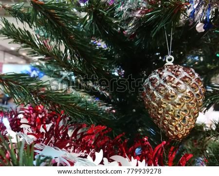Christmas decoration. Christmas decoration background; Christmas tree and holidays ornament. #779939278