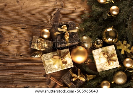 christmas decoration christmas presents in boxes on a wooden background with copy space golden