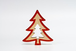 Christmas decoration, Christmas tree, made of natural wood, with a red outline, on a white isolated background.