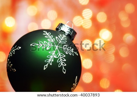 Christmas Decoration--Closeup of green christmas ball with abstract light background.