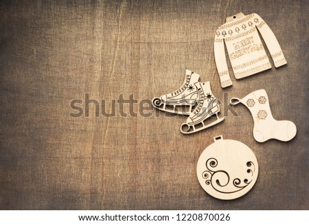 christmas decoration concept with toys at wooden background texture, top view #1220870026