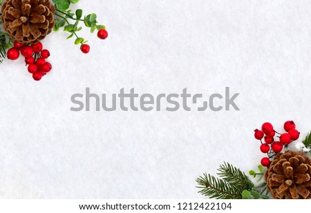Christmas decoration. Frame of twigs christmas tree, brown natural pine cones and red berries on snow with space for text. Top view, flat lay #1212422104