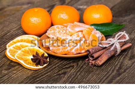 Christmas decoration from spices and fruits on christmas table. #496673053