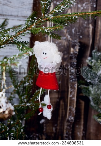 christmas decoration handmade toys hanging over rustic wooden background. nostalgic retro style toned picture