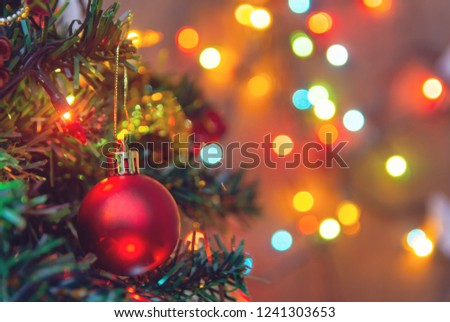 Christmas decoration. Hanging red balls on pine branches christmas tree garland and ornaments over abstract bokeh background with copy space #1241303653