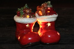 Christmas decoration hollow ceramic Santa boots lit from within with tea light candles