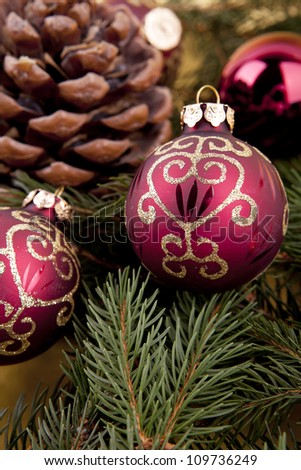 christmas decoration in gold and red on green background with tree space for text