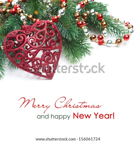 Christmas decoration in the form of heart, spruce branches and garland isolated on white