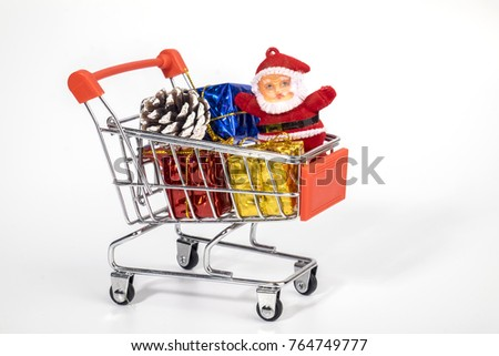 Christmas decoration in trolly on white background isolated. Shopping concept