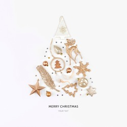 Christmas decoration laid out in the shape of a Christmas tree. Top view. Flat lay