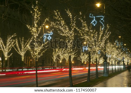 Christmas decoration light bulb garlands on a row of trees, Andrassy boulevard, Budapest, Hungary
