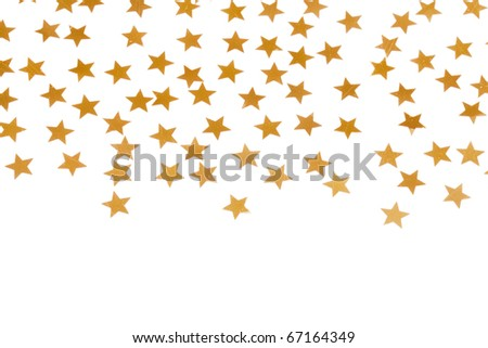 Christmas decoration of golden confetti stars against white background with nice bokeh