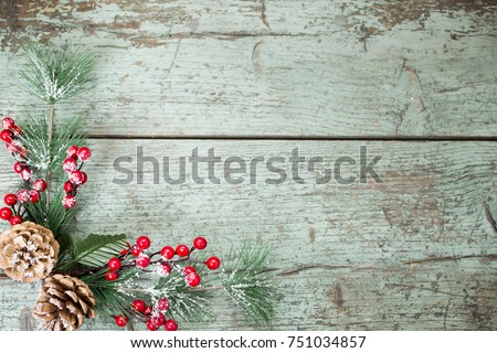 Christmas decoration of mistletoe, holly with berries,ivy and pine cones #751034857