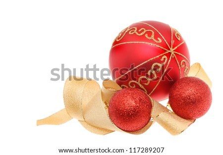 Christmas decoration of red and gold glitter baubles with a coiled gold ribbon isolated against white