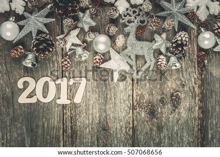 Christmas decoration on abstract background,vintage filter. Instagram colors toning. Xmas card and gift. Winter holidays theme. Top view.Empty space for text. #507068656