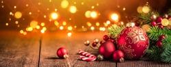 Christmas decoration on blurred golden lights background