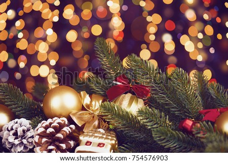 christmas decoration on dark illumated background with boke lights, gifts, xmas ball, cone and other object, holiday concept
