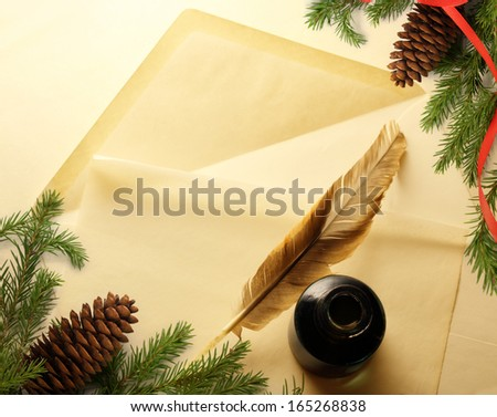 Christmas decoration on envelope with inkwell and feather