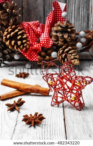 Christmas decoration on the background of the Christmas wreath with pine cones #482343220