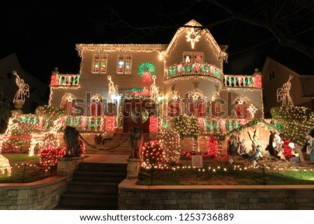 Christmas decoration on the house. Outdoor Christmas lights. Dyker Heights area, Brooklyn, NY.