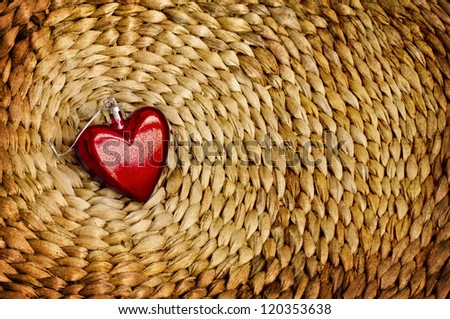christmas decoration on vine woven basket/christmas ornaments on natural wicker background/valentines day background/ red heart  on natural background