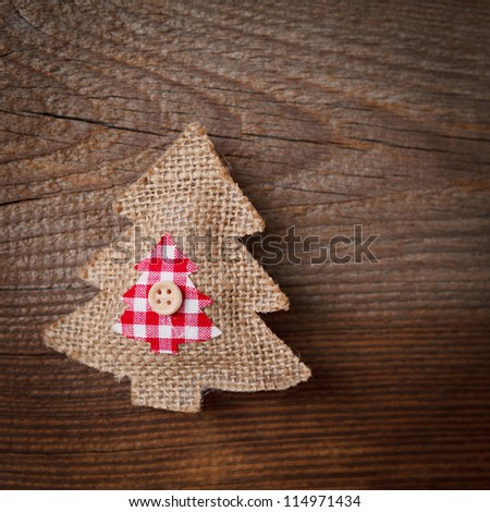 christmas decoration on weathered wooden board