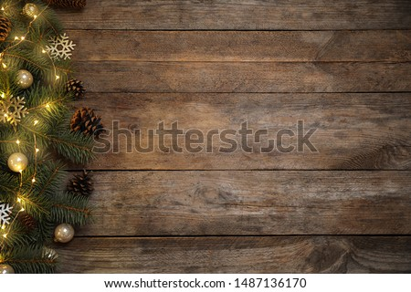 Christmas decoration on wooden background, flat lay. Space for text