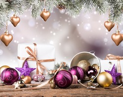 Christmas decoration on wooden background with free space. Celebration balls and other decoration. Christmas concept