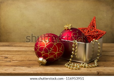 Christmas decoration on wooden table over grunge background