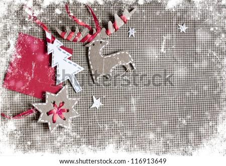 Christmas decoration over grunge  background/vintage paper christmas decoration with a sign and red ribbon