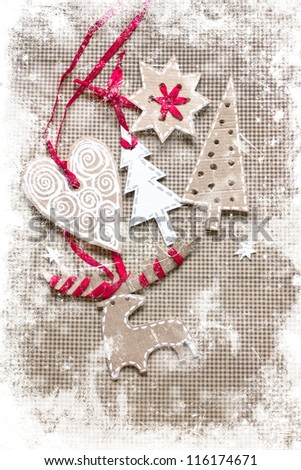 Christmas decoration over grunge paper background/old paper bordering with christmas decoration with a sign