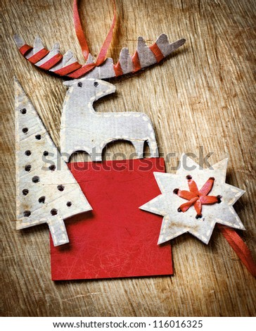 Christmas decoration over grunge wooden background/old paper bordering with christmas decoration