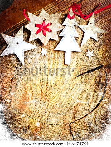 Christmas decoration over grunge wooden background/ Old wood cut texture/The texture of wood cut across. Can be used as background for christmas holidays