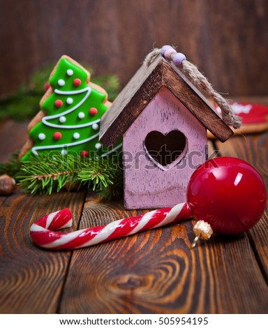 Christmas decoration over the dark wooden background #505954195