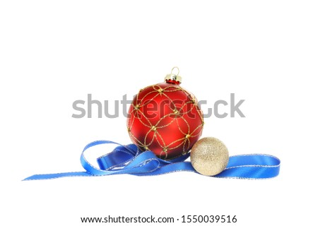 Christmas decoration, red and gold baubles with coiled blue and silver ribbon isolated against white #1550039516