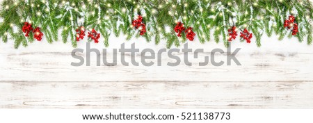 Christmas decoration red berries and golden lights. Christmas holidays banner #521138773