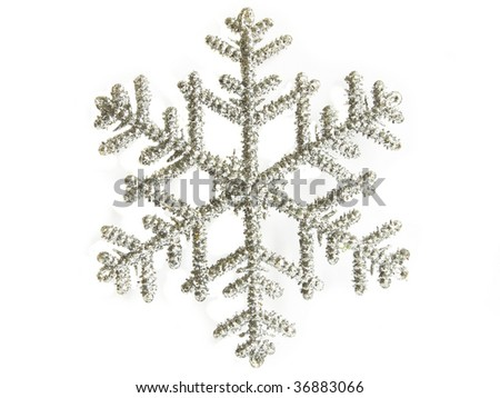 Christmas decoration silver snowflake, isolated over white.