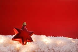 Christmas decoration star with snow  on red background