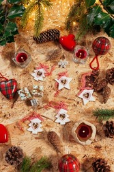 Christmas decoration still life with pinecone, candles, christmas stars, leds lights and tree decoration