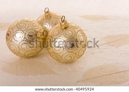 Christmas decoration: Three elegant golden baubles